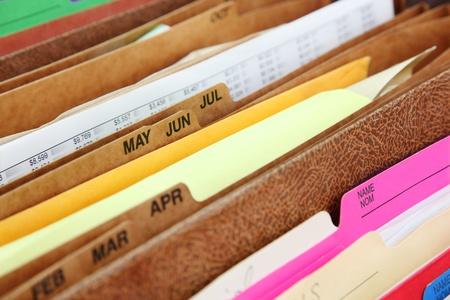 Files  Closeup of folders in expending file pockets Foto de archivo
