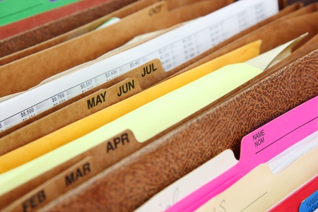 card file: Files  Closeup of folders in expending file pockets Stock Photo