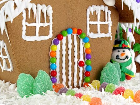 Closeup of gingerbread house and snowman  photo