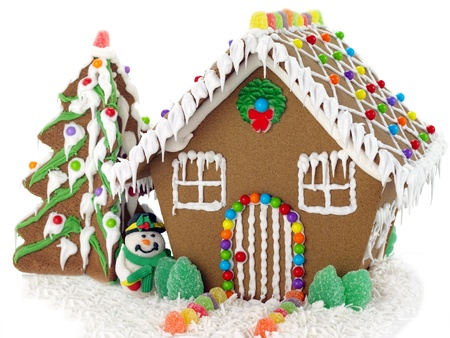 Gingerbread house and christmas tree on the white background   photo
