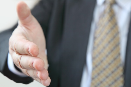 grasp: Closeup of businessman ready to give handshake , open gesture Stock Photo