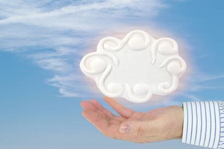 Hand holding a cloud computing concept on the blue sky photo
