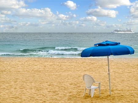 Umbrella with chair on the beach photo