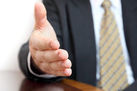 congratulating: Closeup of male hand during discussion in the office