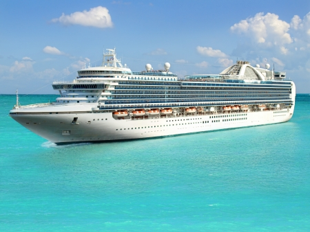 Luxury cruise ship sailing from port photo