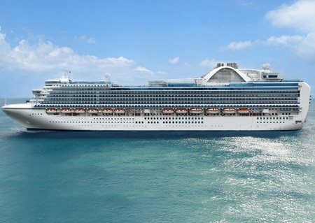 caribbean cruise: Luxury cruise ship sails away at sunny day Stock Photo