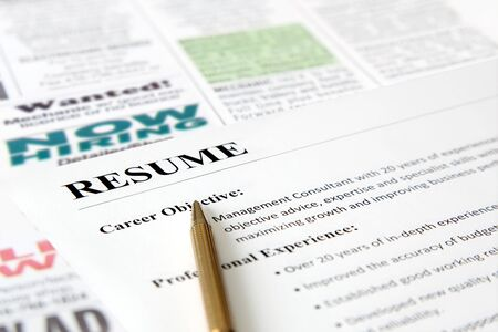 job opening: Closeup of resume with pen on the newspaper  Stock Photo