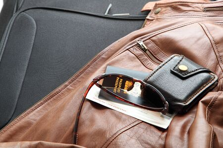 necessities: Leather Jacket with Travel Necessities Ready to Travel