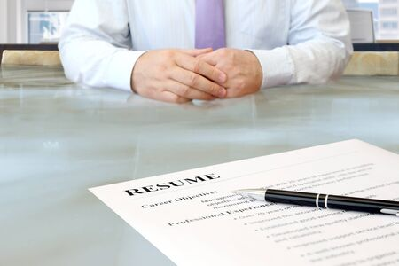 job occupation: Job interview in the office with focus on resume and pen Stock Photo