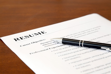Closeup of Resume with Pen on the Table  photo