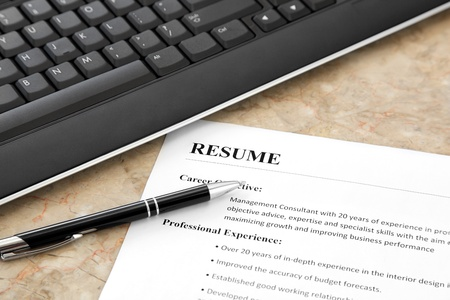 recruit: Resume with Pen and Keyboard on the Table