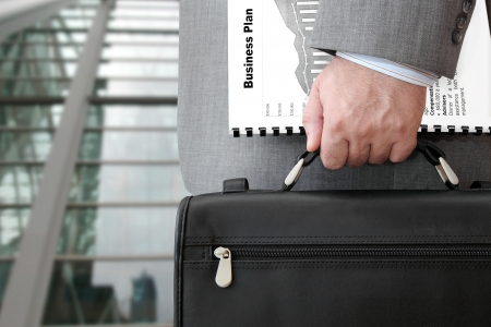 Businessman with Business Plan and Briefcase Ready for Meeting
