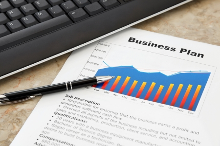Business Plan with Pen and Keyboard on the Table