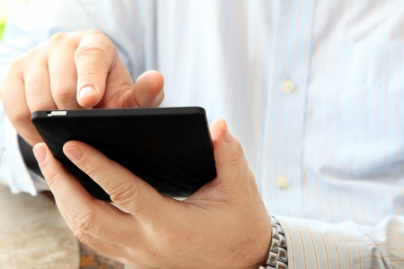 pocket pc: Close up of Man Calling by Phone Stock Photo