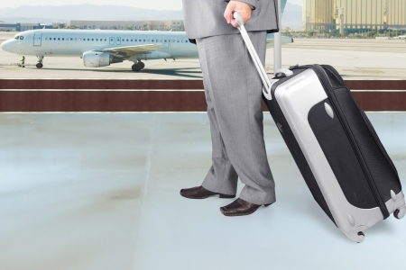 Traveling Businessman with His Luggage in the Airport