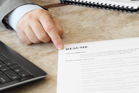 Job Interview in the Office with male hand and Resume on the Table Reklamní fotografie