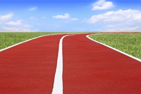 jogging track: Running track and field on blue sky background