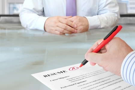 hire: Job Interview in the Office with Focus on Resume and Pen Stock Photo