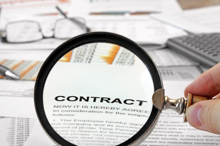 writing on glass: Magnifying Glass Over Contract Papers