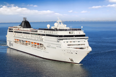 accommodate: Lisbon, Portugal - October 02, 2014: Cruise Line MSC, cruise ship MSC Opera sails from port Lisbon in Portugal  on October 02, 2014. She can accommodate 2,055 passengers in 856 cabins.
