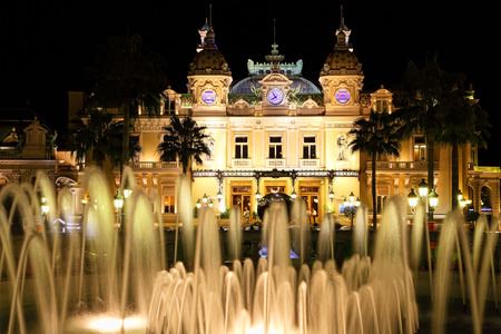 Monte Carlo, Monaco - October 07, 2014: Famous Grand  Casino  in Monte Carlo at night on October 07, 2014 in Monaco. Grand  Casino is  the world?s most prestigious Casino opened in 1863. Stock Photo - 35494218