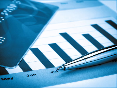 Credit Card and Pen on the Chart Stock Photo