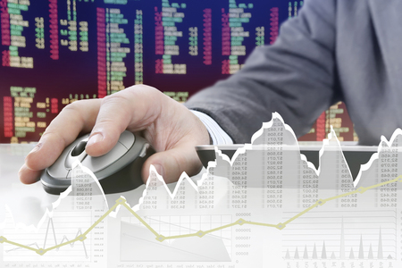 technology market: Man analyzing financial data and charts on computer Stock Photo