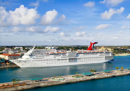 fascination: NASSAU, BAHSMAS - APRIL 15, 2015: The Carnival Cruise Ship Fascination in port of Nassau, Bahamas.  Nassau is one of the most popular cruise port destinations in the Caribbean.