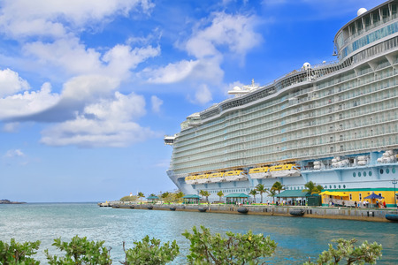 Nassau, Bahamas - April 13, 2015: Royal Caribbean cruise ship Allure of the Seas  docked at port of Nassau, Bahamas on April 13, 2015. Its the largest passenger ship ever built