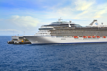 MONTE CARLO, MONACO - OCTOBER 07, 2014: Oceania Cruises ship Marina  docked at port of Monte Carlo. Marina blends sophistication with a contemporary flair to create a casually elegant ambiance Editorial