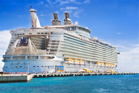PHILIPSBURG, ST. MARTEEN - APRIL 16,2015: Cruise ship  Allure of the Seas, docked at Philipsburg, St. Marteen harbor on a sunny day.