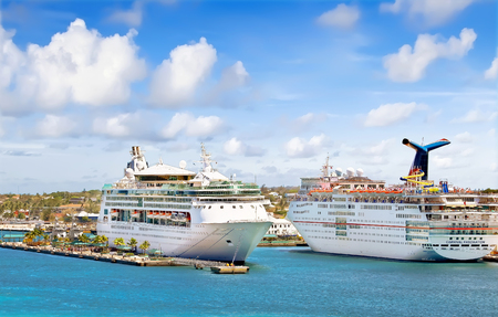 grandeur: NASSAU, BAHAMAS - APRIL 13, 2015: Royal Caribbean cruise ship Grandeur of the Seas and Carnival Fascination docked at port on the sunny day Editorial