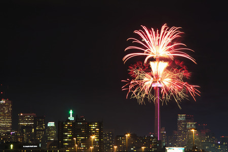 pyrotechnics: TORONTO - JULY 01, 2017:Fireworks set off from famous  CN tower light up Toronto sky to mark Canadas 150th anniversary. CN Tower is a global cultural icon of Canada and one of the most recognizable structures in the world. Editorial