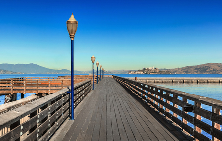 Wooden pier at the bay on sunny day