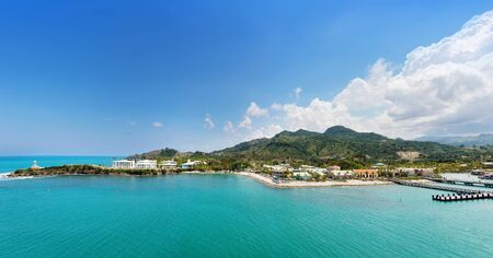 Panorama of tropical island with port and resort