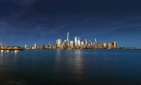 Panorama New York City  with Manhattan Skyline over Hudson River in the evening.