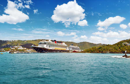 ST. THOMAS, US VIRGIN ISLANDS - March 27, 2019:  Cruise ship Disney Fantasy docked at St Thomas, on sunny day.