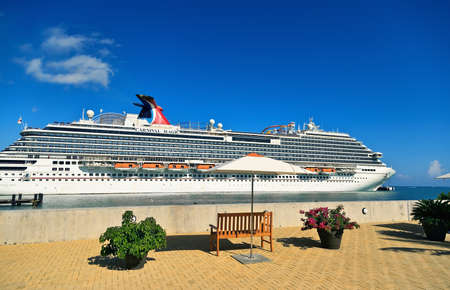 AMBER COVE, PUERTO PLATA, DOMINICAN REPUBLIC - MARCH 26, 2019: Cruise ship Carnival Magic docked at port Amber Cove on sunny day