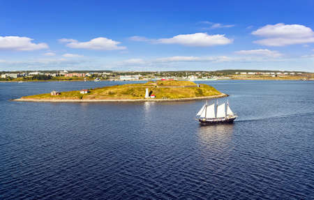 HALIFAX, NOVA SCOTIA, CANADA - SEPTEMBER 13, 2019: Panoramic view of Halifax Harbor with lighthouse and touristic sail ship in  on sunny day