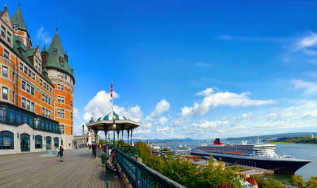 QUEBEC CITY, CANADA - SEPTEMBER 09, 2019: RMS Queen Mary 2 is the largest ocean liner ever built, having served as the flagship of the Cunard Line docked at port Quebec City