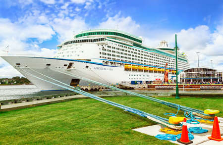 SYDNEY, NS, CANADA - SEPTEMBER 12, 2019: Cruise ship Royal Caribbean Adventure of the Seas docked at port Sydney. The tourist region is a popular Canadian cruise destination