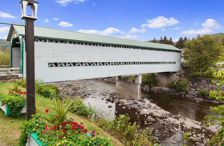 Covered bridge Pont du Faubourg  in the village of L'Anse-Saint Jean, Quebec, Canada