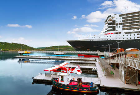 SAGUENAY, QC, CANADA - SEPTEMBER 10, 2019: RMS Queen Mary 2 cruise ship docked at port. She is the largest ocean liner ever built, having served as the flagship of the Cunard Line