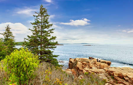 Panoramic view of Bar Harbor with rocky coast  and small islands on a sunny day