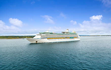 SYDNEY, NS, CANADA - SEPTEMBER 12, 2019: Cruise ship Royal Caribbean Adventure of the Seas sailing to port Sydney. The tourist region is a popular Canadian cruise destination