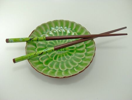 oriental plate and chopsticks Imagens - 4229818