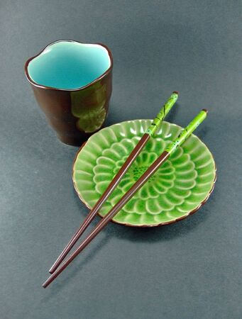 oriental plate cup and chopsticks