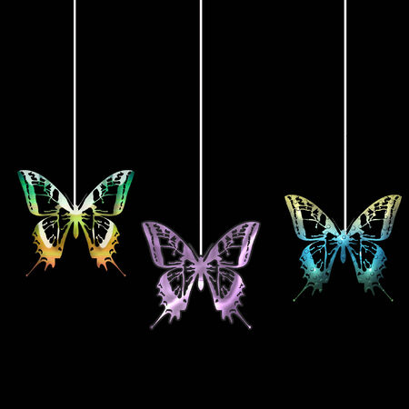 several pretty and colorful butterflies hanging on strings
