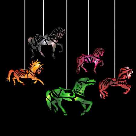 several carousel horses hanging from strings