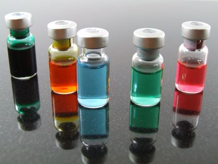 several vials of colored medicine